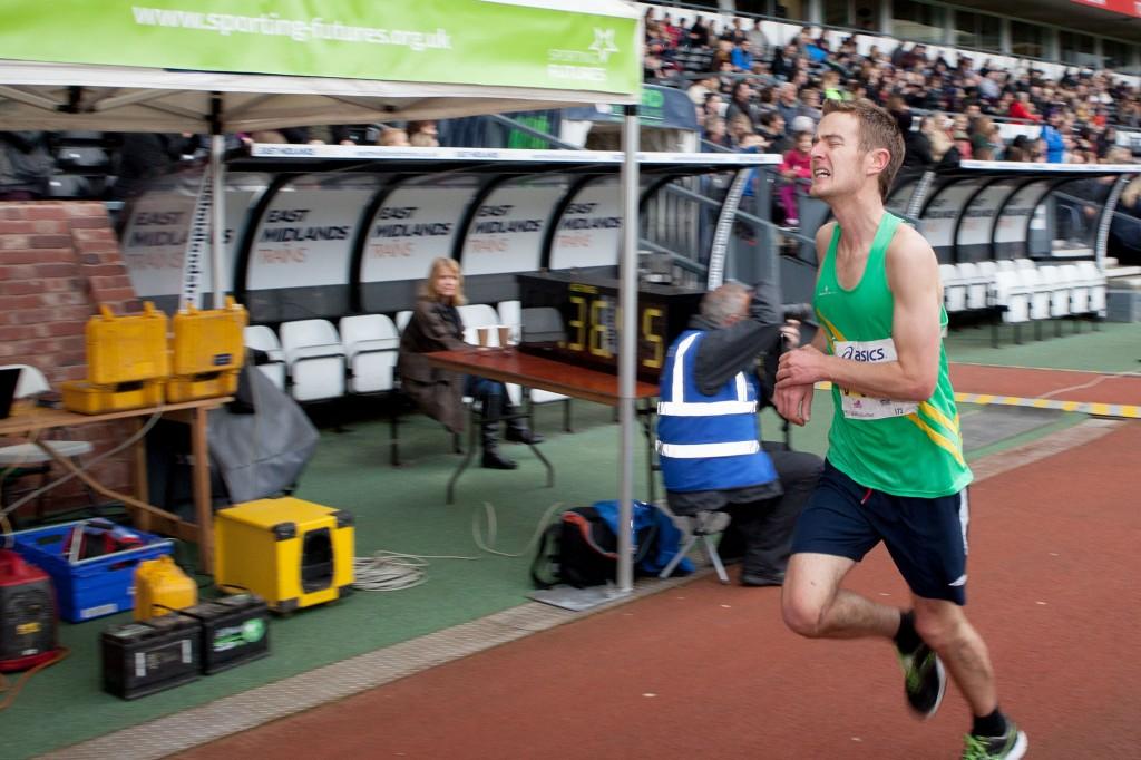 Runner sprinting for the line Derby 10k