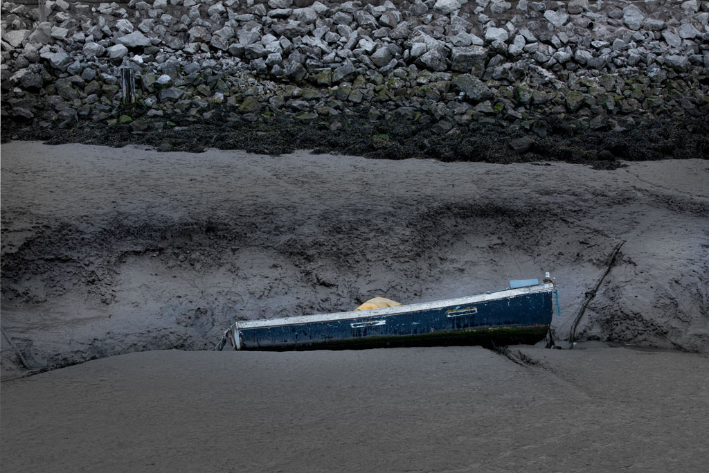 Blue boat on mud at Greenfild Dock, Dee Estuary