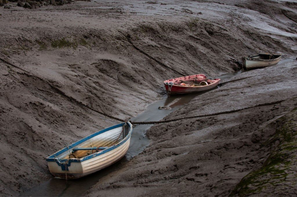 Three Boats at low tide. Greefield dock on the Dee Estuary