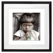 Young girl drinking water from an old 7 Up bottle black frame