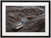 Boats beached on a mud flat on the Dee estuary