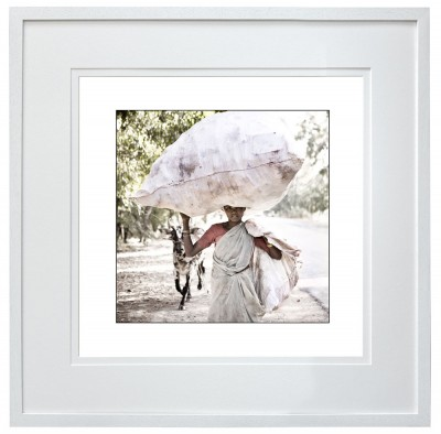 Young female plastic bottle collector India, white frame
