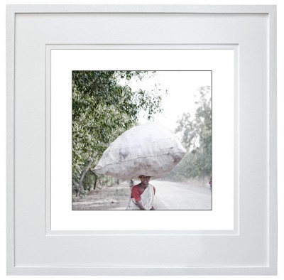 Young female plastic bottle collector India 2 of 2 white frame