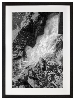 White Water Gushing through rock channel in black frame