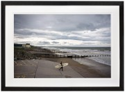 Winter surfer on Tywyn Beach North Wales