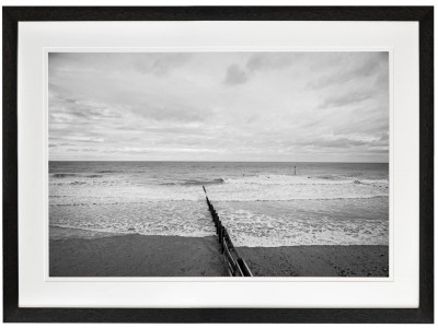Winters day on Tywyn Beach four surfer head out to get th wavesblack frame
