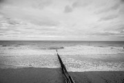 Winters day on Tywyn Beach four surfer head out to get th waves Wales bw