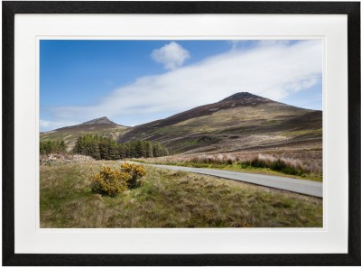 Yr Eifl and the road to Nant Gwrtheyrn in black frame