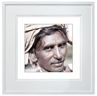 Itinerant road laborer India white frame border