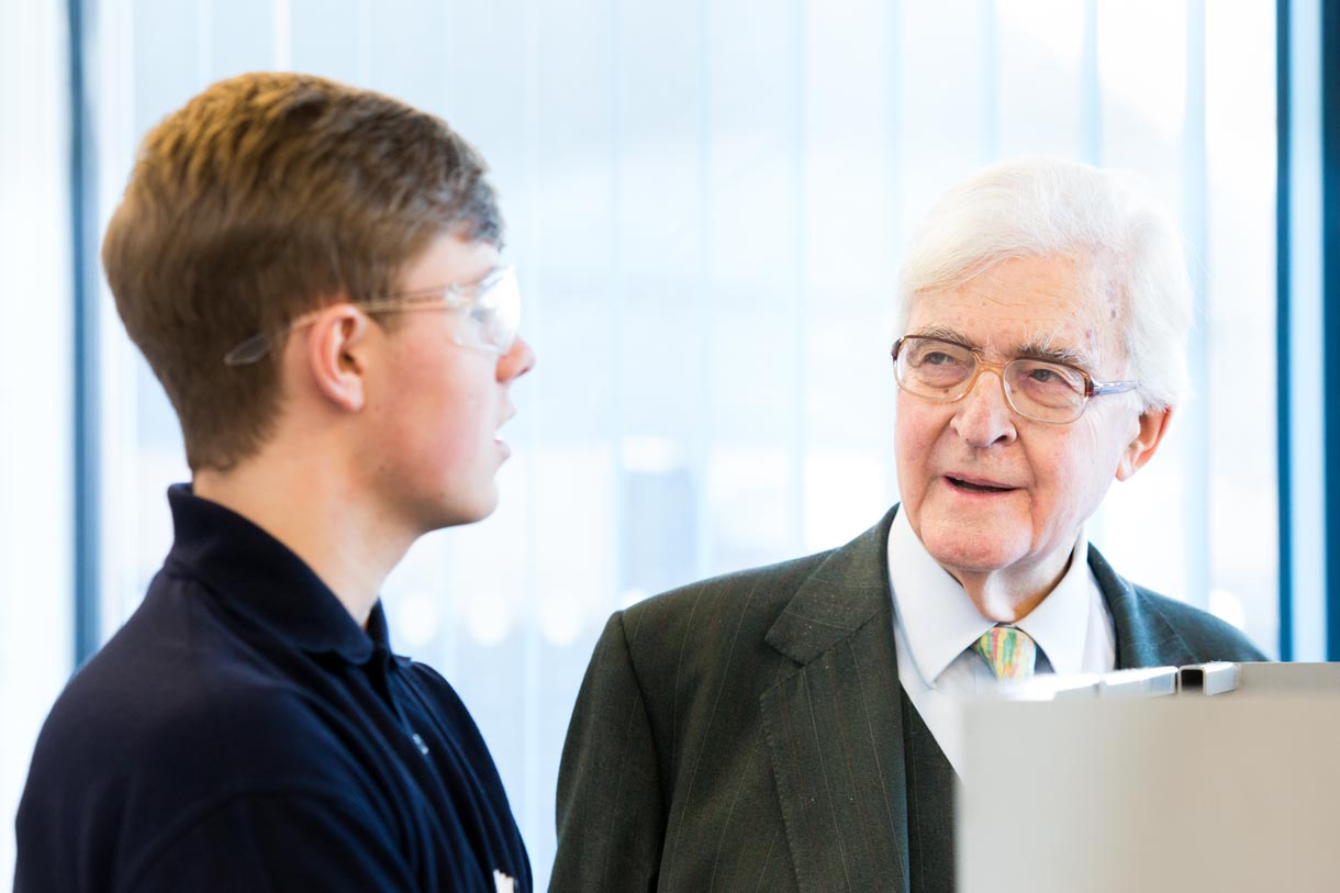 Lord Baker talking to a student