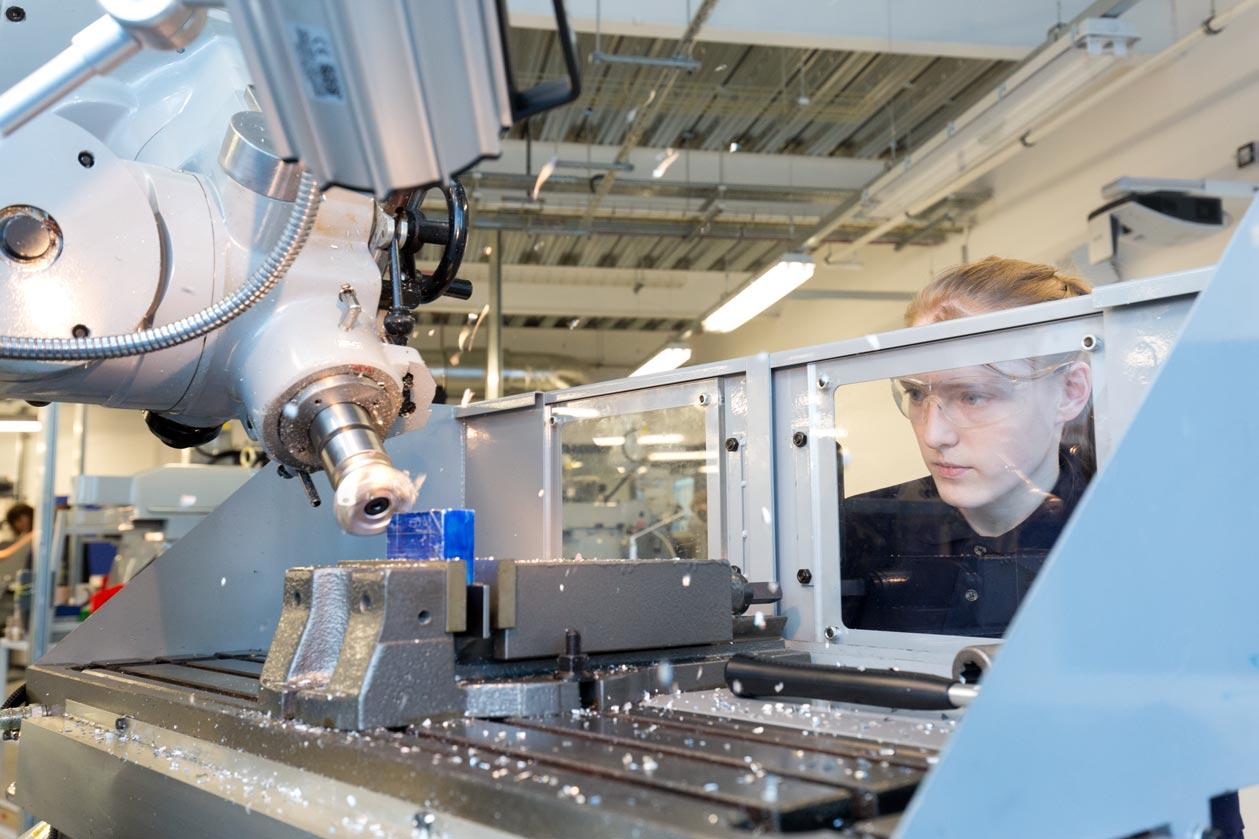 female engineering student on milling machine