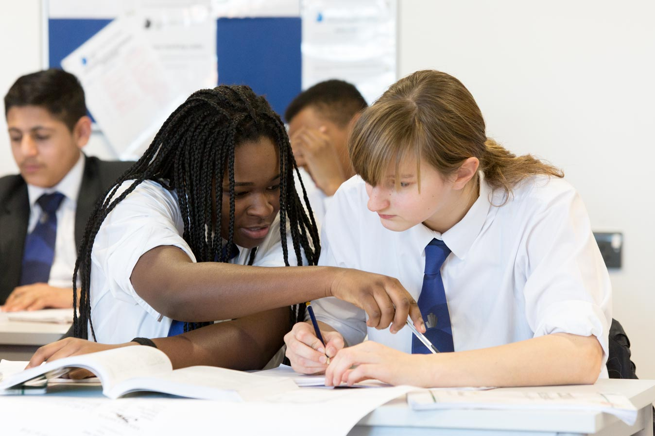 UTC students in working together in class room