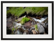 abandoned quarry debris in stream Nant Gwrtheyrn North Wales black frame