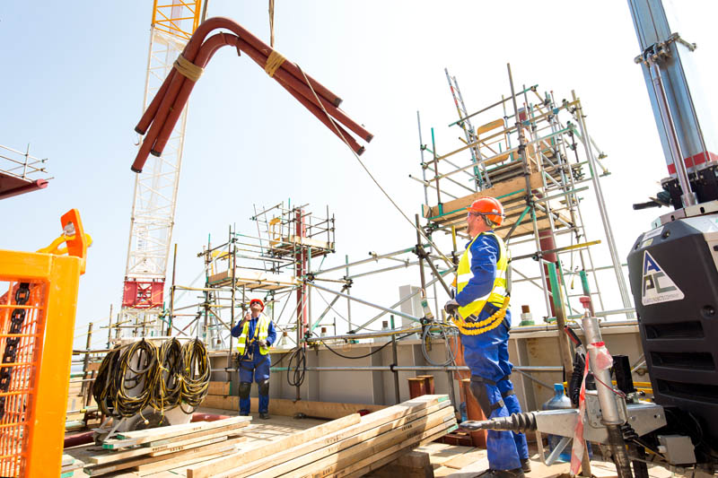 construction workers loading