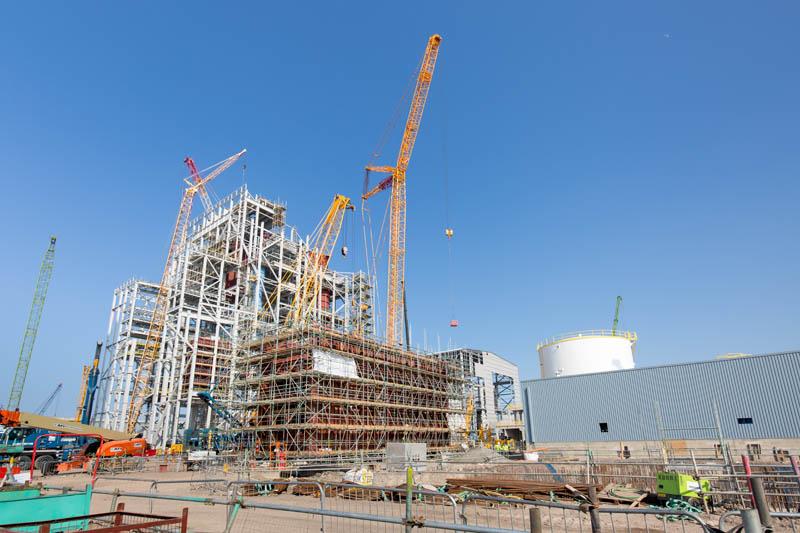 Yellow cranes ans steel work construction