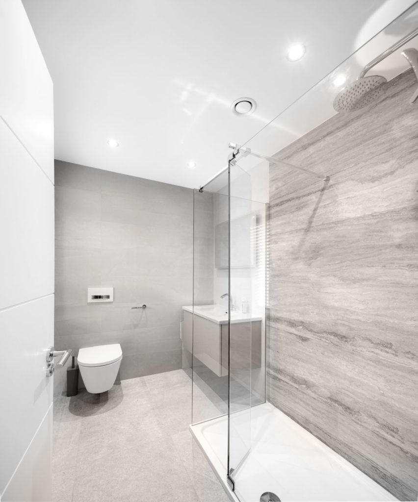 Walk in glass shower with grey slate tiles in contemporary showerroom