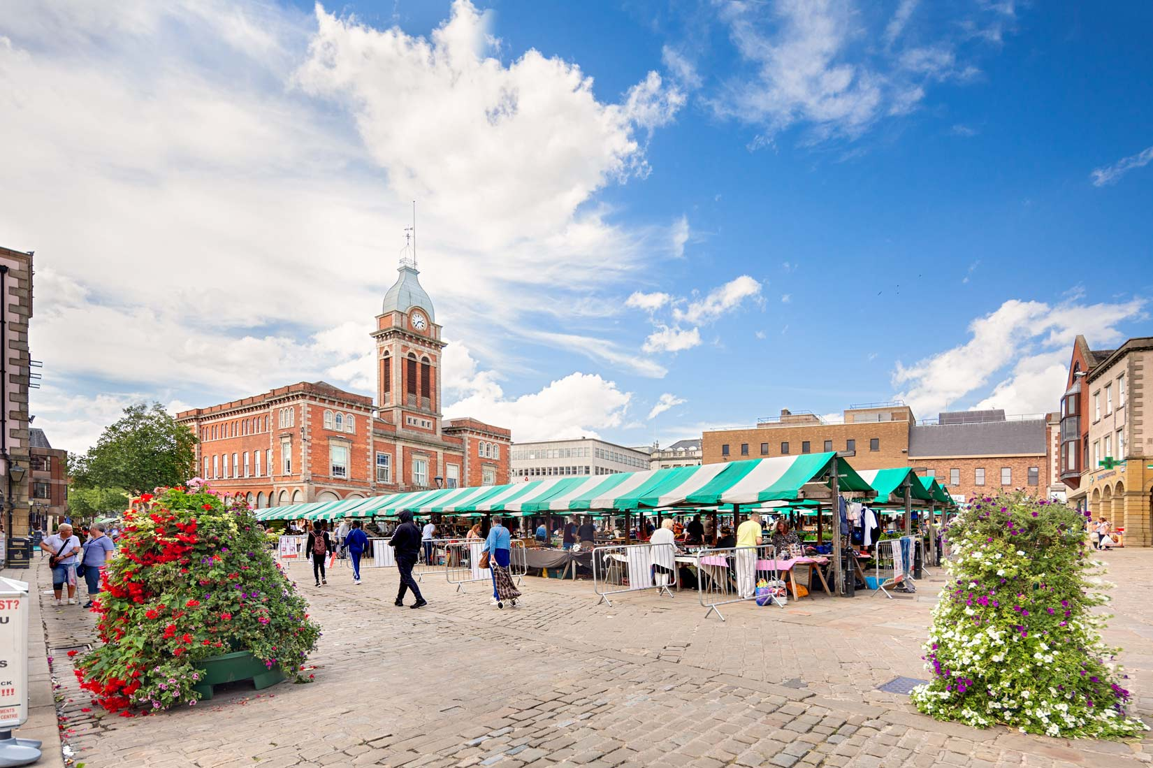 A sunny Chesterfield market with market hall in th background