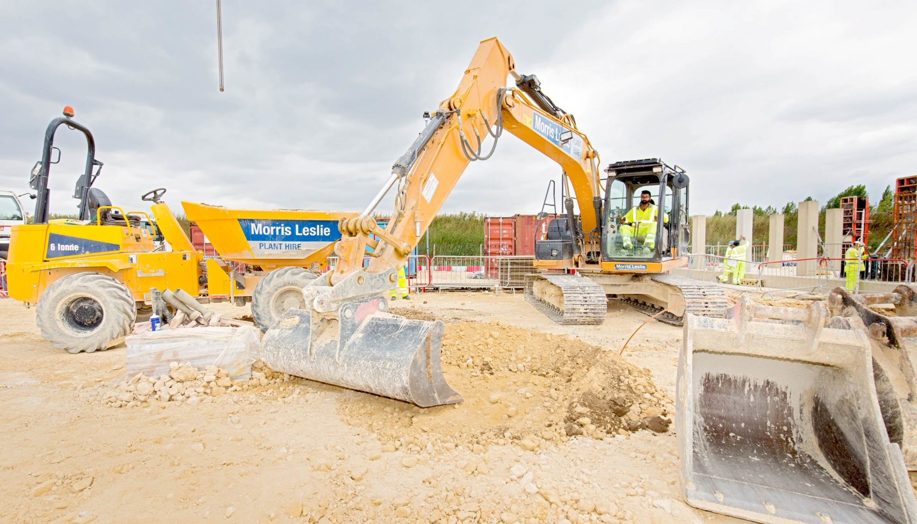 Close up of excavator on construction site, bucket in forefront of shot