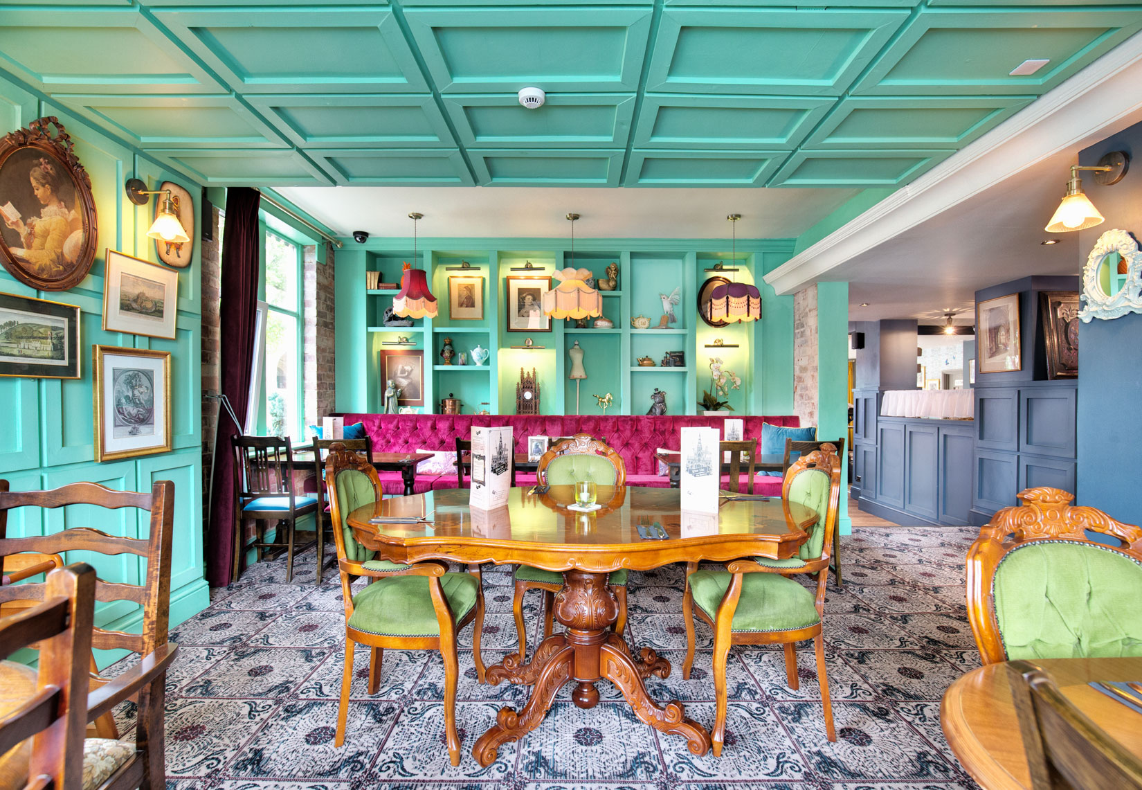 Pub restaurant interior Photography located in Chesterfield, fuchsia pink velvet green wall and floor panelling by interior photographer Matthew Jones