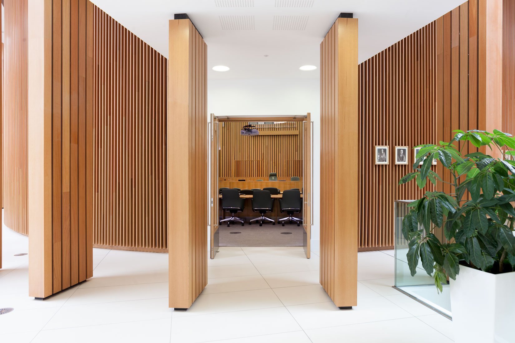Interior Photography of Derby City Council Reception double height space and vertical wooden slats floor to ceiling  by interior photographer Matthew Jones