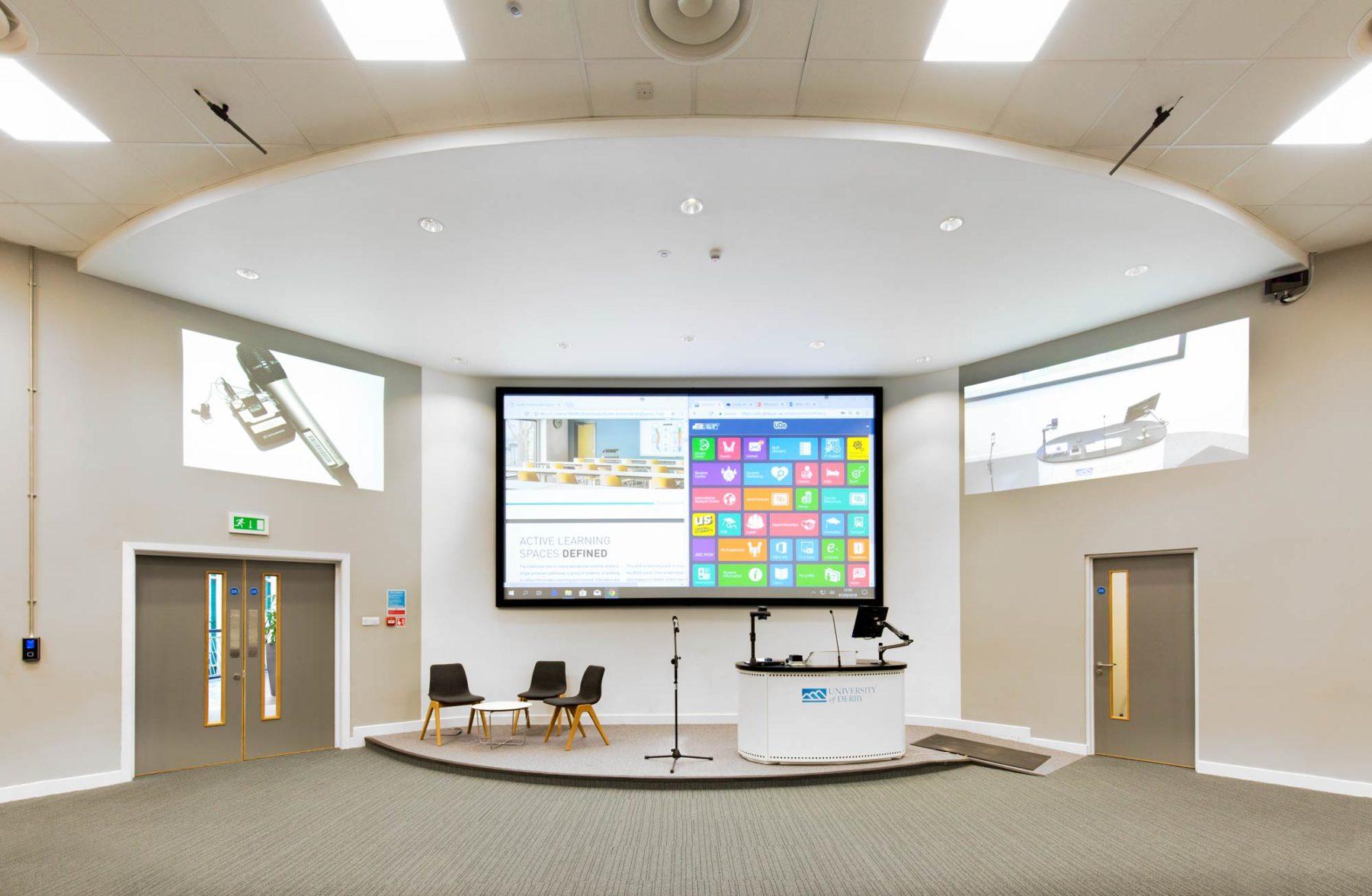 Multimedia interior showing huge viewing screen and lectern by interior photographer Matthew Jones