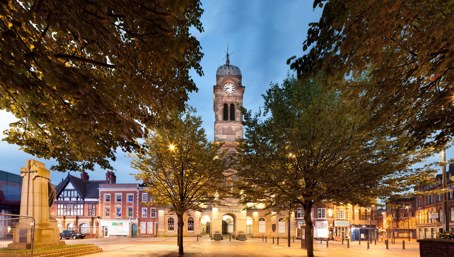 Derbys Guild Hall as dusk taken from behind trees for places marketing purposes
