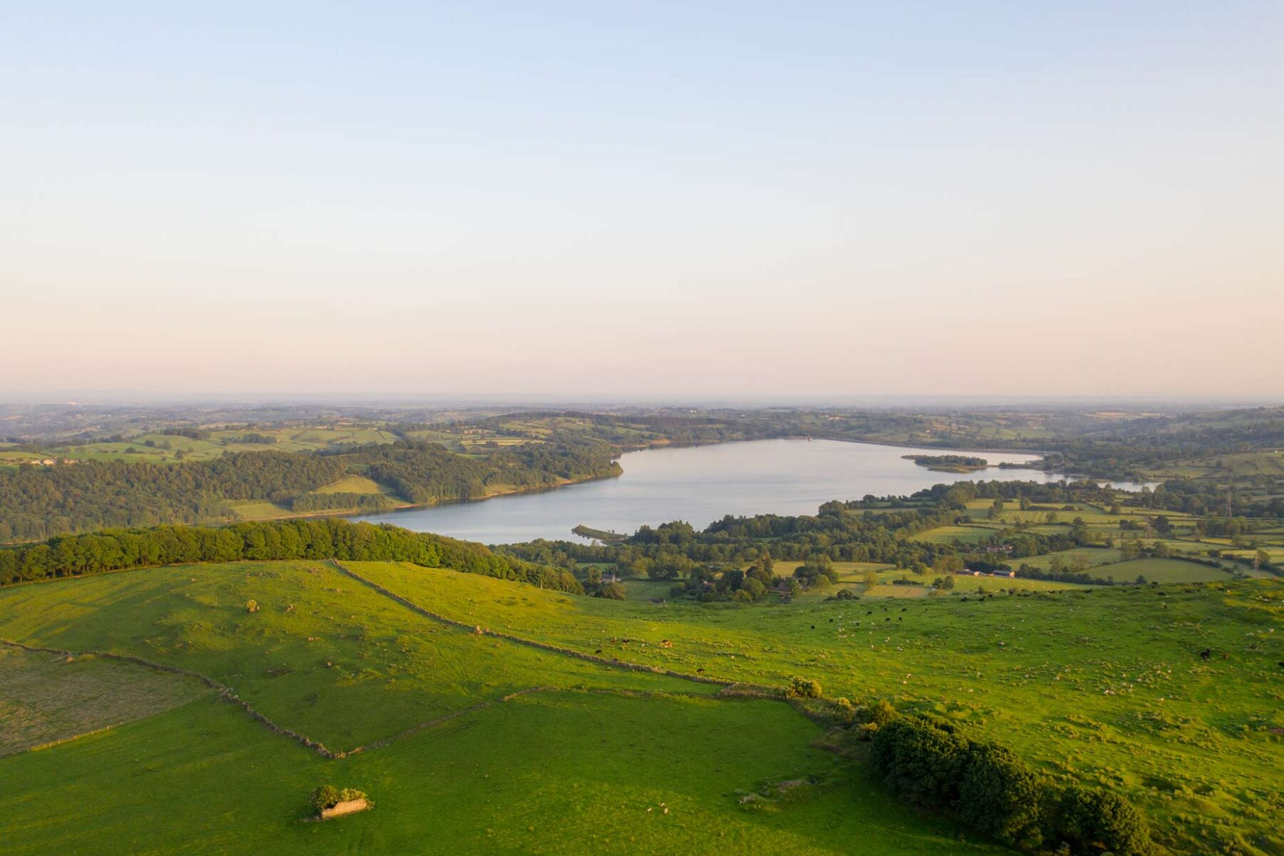 View of Carsington water frem the Senvion MM82 wind turbine on a summer eveing