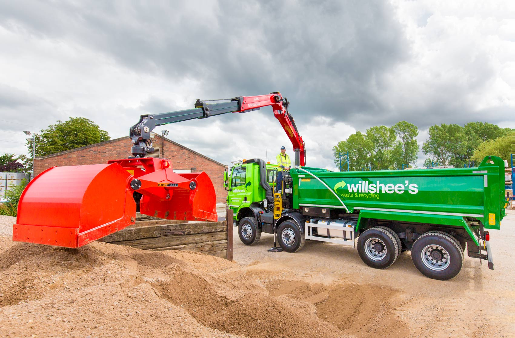Grab-truck-at-loading-with-sand