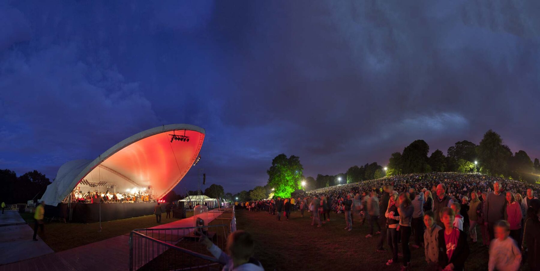 Darley Park Concert at dusk with stage left and crowd right