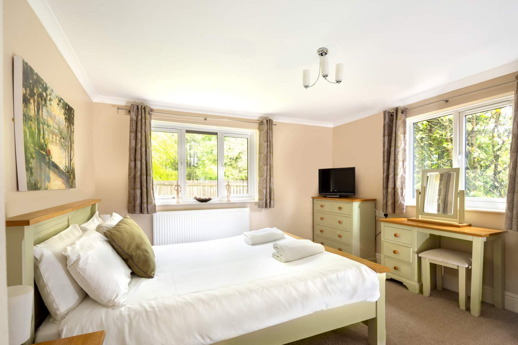 Interior Photography of cottage sage double bedroom by interior photographer Matthew Jones
